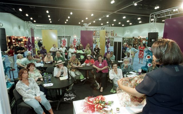 Shirley George Frazier training retailers at the California Gift Show. All rights reserved.
